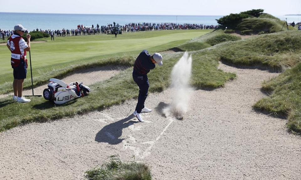 Xander Schauffele, who won both his matches on Friday, hits out of a bunker on the second.
