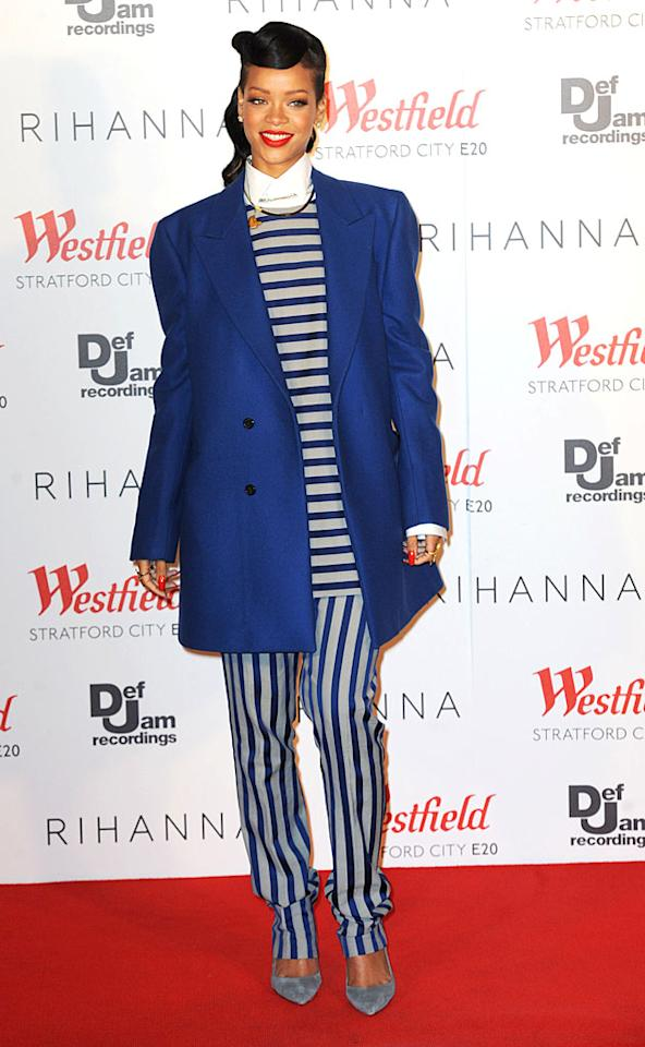 "Rihanna looked like she stepped right out of the ""Working Girl""-era of the '80s on Monday at a Christmas tree lighting in London thanks to her oversized menswear ensemble. As if the blue blazer with huge shoulder pads wasn't bad enough, she opted to pair it with a horizontally-striped top and vertically-striped pants. Not hot. (11/19/2012)"