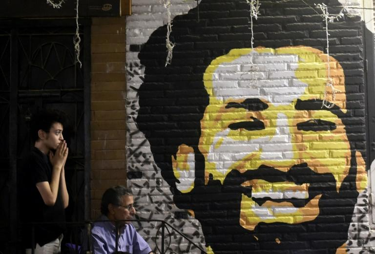 A man reacts as he watches the the UEFA Champions League final football match, between Real Madrid and Liverpool, at a coffee shop in the Egyptian capital Cairo on May 26, 2018