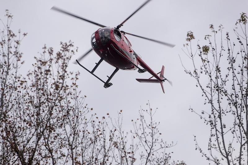 The USDA Wildlife Services helicopter used for feral pig control at Land Between the Lakes is painted red and black with an almost wave design on the side.
