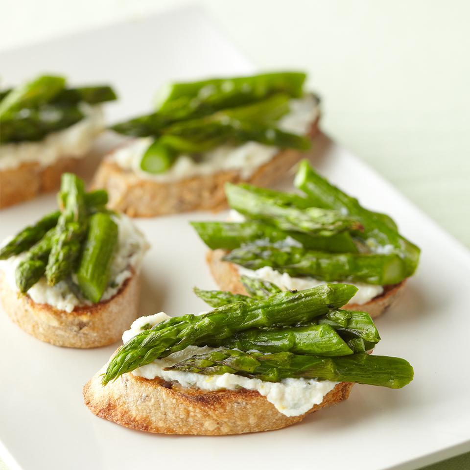 <p>Toasted French bread slices get a topping of seasoned ricotta cheese and roasted asparagus spears for an appetizer or small bite that's perfect for summer entertaining.</p>