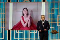 """Rosamund Pike accepts the Best Actress - Motion Picture - Musical/Comedy award for """"I Care a Lot"""" in this handout photo from the 78th Annual Golden Globe Awards in New York"""