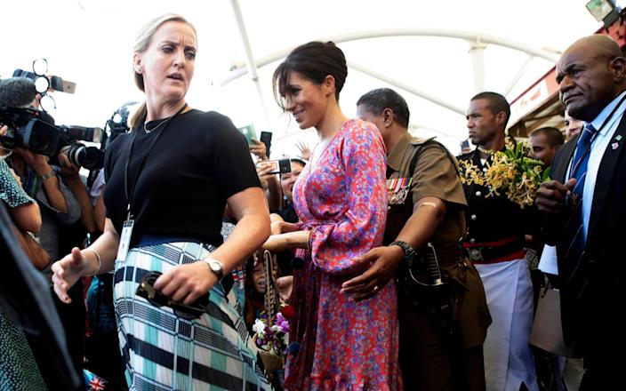 The Duchess of Sussex is escorted through a market in Suva, Fiji - Ian Vogler/PA