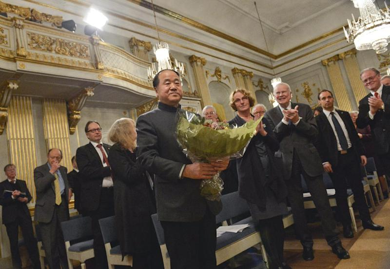 The 2012 Nobel Literature Prize laureate, Mo Yan of China receives applause from Academy members after speaking during the traditional Nobel lecture Friday Dec. 7, 2012 at the Royal Swedish Academy in Stockholm, Sweden. (AP Photo/Jonas Ekstromer)