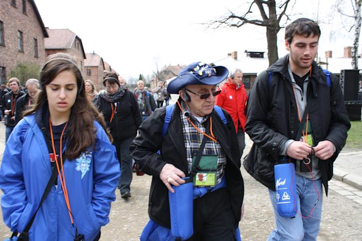 Max Glauben (center) guided Jori Epstein (left) through concentration camps, including Auschwitz in Poland, in 2012.