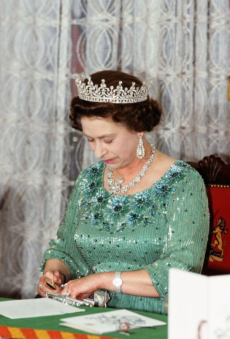 <p>Even just from the waist up, Queen Elizabeth reminds us of Ariel in her light green sequin embossed gown, while attending a state banquet on a visit to Kenya in 1981. </p>