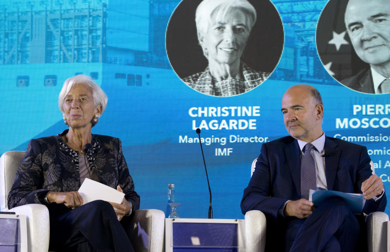 Managing Director of International Monetary Fund (IMF) Christine Lagarde, left, and European Commissioner for Economic and Financial Affairs Pierre Moscovici attend a seminar in Bali, Indonesia, Wednesday, Oct. 10, 2018. (AP Photo/Firdia Lisnawati)