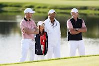 Daniel Berger, Captain's assistant Tiger Woods, Captain Steve Stricker of the US Team and Erica Herman talk during Friday four-ball matches of the Presidents Cup, at Liberty National Golf Club in Jersey City, New Jersey, on September 29, 2017 (AFP Photo/SAM GREENWOOD)