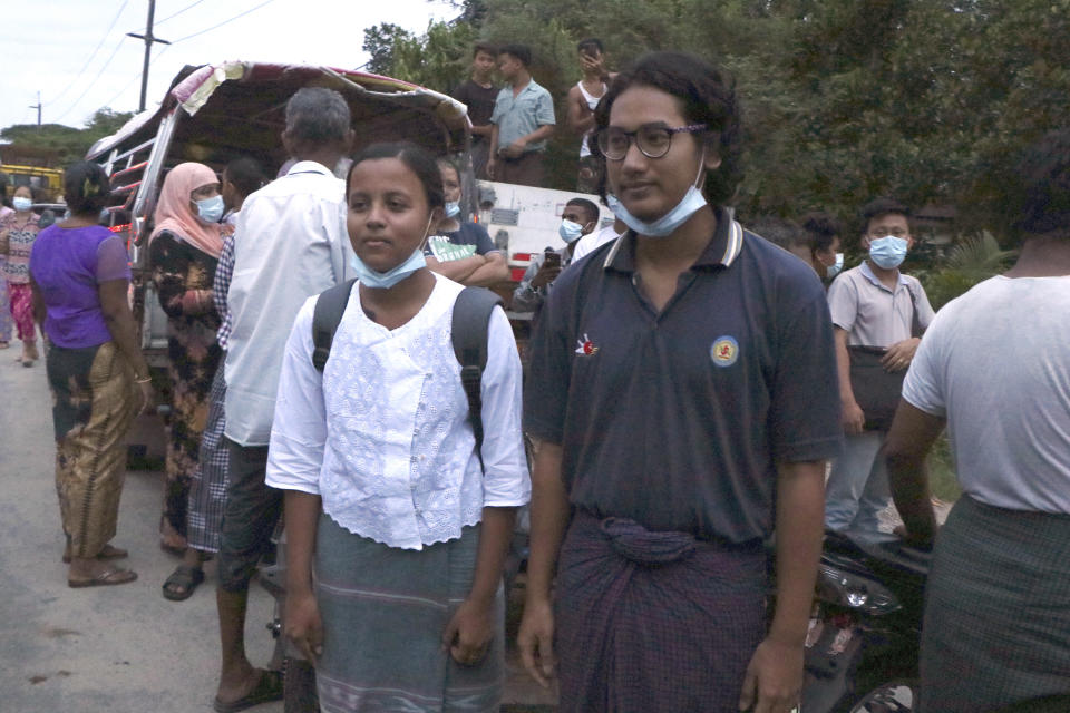FILE - In this June 30, 2021, file photo, journalists Kay Son Nway, left, and Ye Myo Khant, right, stand together after their release from Insein Prison in Yangon, Myanmar. Myanmar's government began releasing about 2,300 prisoners on June 30, including activists who were detained for protesting against the military's seizure of power in February and journalists who reported on the protests, officials said. Media and human rights advocates say journalists in Myanmar are in extreme peril as the military-controlled government cracks down on independent reporting. (AP Photo, File)