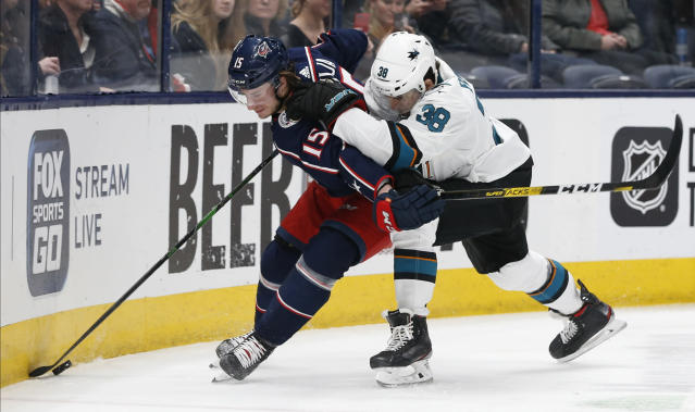 San Jose Sharks' Mario Ferraro, right, chases Columbus Blue Jackets' Jakob Lilja, of Sweden, behind the net during the second period of an NHL hockey game Saturday, Jan. 4, 2020, in Columbus, Ohio. (AP Photo/Jay LaPrete)