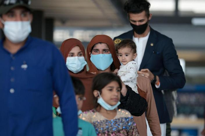 Afghan Refugees Arrive At Dulles Airport After US Pulls Out Final Troops