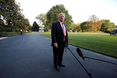 U.S. President Donald Trump talks to the media on South Lawn of the White House in Washington before his departure to Greensboro, North Carolina, U.S., October 7, 2017. REUTERS/Yuri Gripas