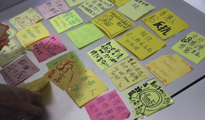 "Sticky notes from the ""Lennon Wall"" inside JMT Coffee. Photo: K. Y. Cheng"