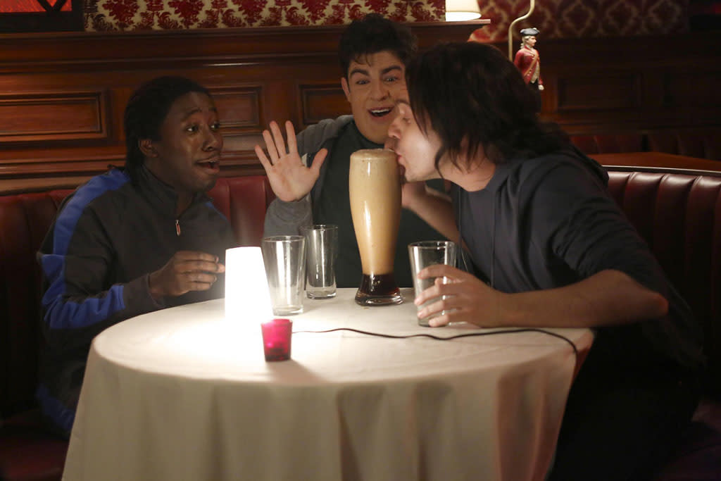 "In a flashback, Winston (Lamorne Morris), Schmidt (Max Greenfield) and Nick (Jake Johnson) play drinking games at the bar in the ""Virgins"" episode of ""New Girl."""