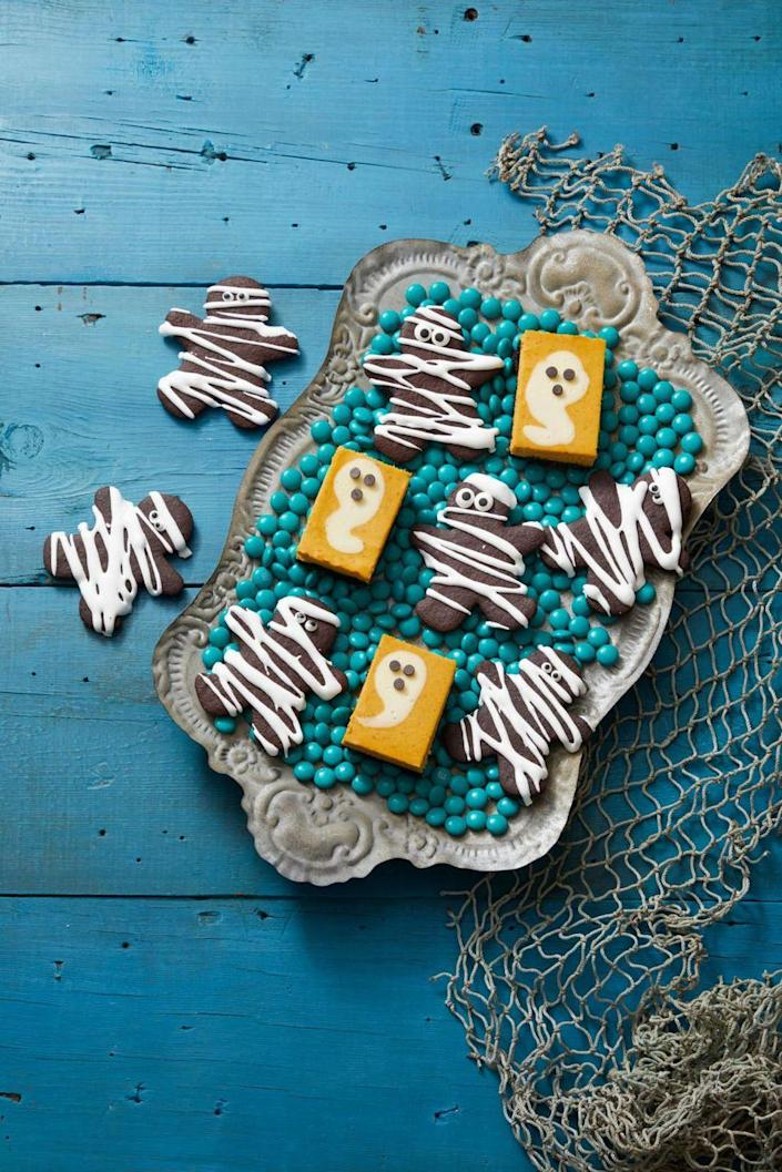 """<p>For a fork-free dessert, you can't go wrong with these pumpkin cheesecake bars. And they get extra festive with the addition of some ghost-shaped cream cheese filling. </p><p><em><strong><a href=""""https://www.womansday.com/food-recipes/a33562053/pumpkin-cheesecake-ghosts-recipe/"""" rel=""""nofollow noopener"""" target=""""_blank"""" data-ylk=""""slk:Get the Pumpkin Cheesecake Ghosts recipe."""" class=""""link rapid-noclick-resp"""">Get the Pumpkin Cheesecake Ghosts recipe. </a></strong></em></p>"""