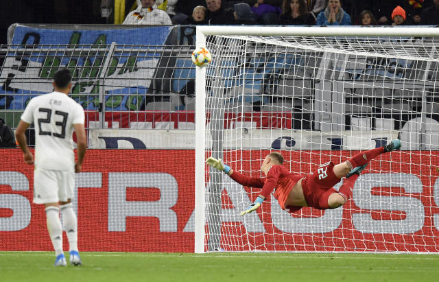 Germany's goalkeeper Marc-Andre Ter Stegen dives to deflect the ball during the international friendly soccer match between Germany and Argentina at the Signal Iduna Park stadium in Dortmund, Germany, Wednesday, Oct. 9, 2019. (AP Photo/Martin Meissner)