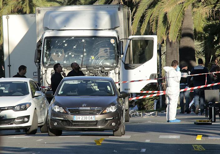 The police look for evidence after a truck ramming incident