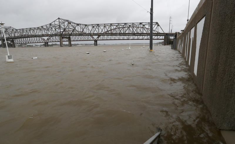 As the Atchafalaya River continues to rise due to the rains of Tropical Storm Barry, it becomes harder to see the Morgan City name on the sea wall, Saturday, July 13, 2019 in Morgan City, La. (AP Photo/Rogelio V. Solis)