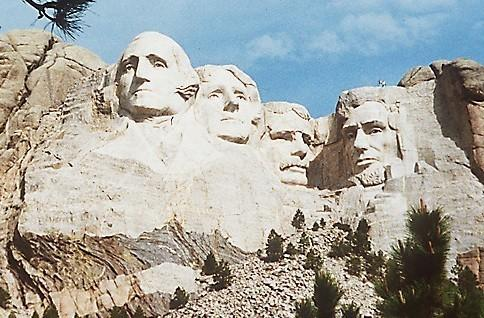 "Mt. Rushmore honors, from left, President Washington and President Jefferson, both slaveholders, and the racist President Theodore Roosevelt. Imagine the conversation President Lincoln would be having with his mountain-mates today. <span class=""copyright"">(Associated Press)</span>"