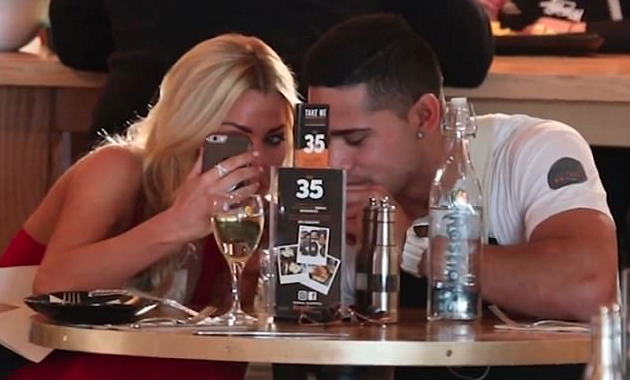 She's seen blowing bubbles with him while taking a video on her phone. Source: KIIS