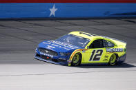 Ryan Blaney comes out of Turn 4 during a NASCAR Cup Series auto race at Texas Motor Speedway in Fort Worth, Texas, Sunday, July 19, 2020. (AP Photo/Ray Carlin)