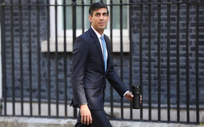 Chancellor Rishi Sunak arrives in Downing Street, London, after the introduction of measures to bring the country out of lockdown. - Jonathan Brady/PA