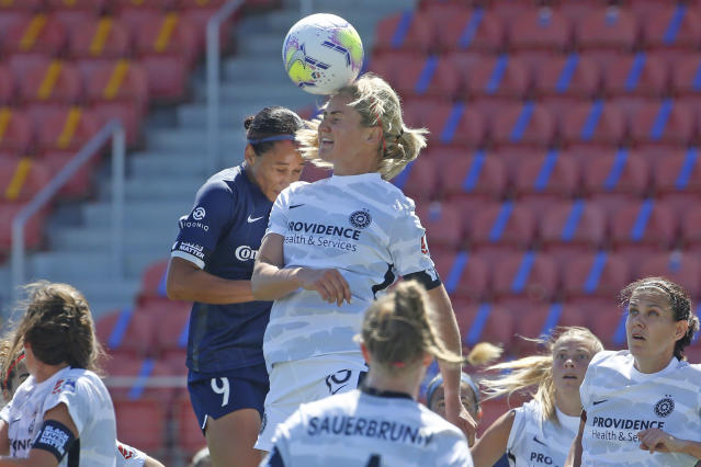 North Carolina Courage forward Lynn Williams (9) and Portland Thorns FC midfielder Lindsey Horan (10) battle for the ball during the first half of an NWSL Challenge Cup soccer match at Zions Bank Stadium, Saturday, June 27, 2020, in Herriman, Utah. (AP Photo/Rick Bowmer)