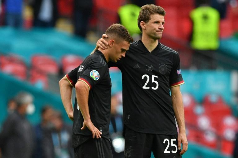 Germany forward Thomas Mueller comforts Joshua Kimmich after their Euro 2020 last 16 defeat to England at Wembley