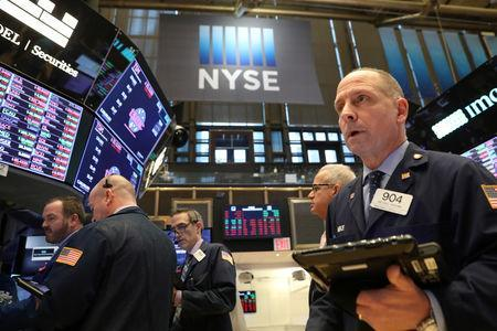 FILE PHOTO: Traders work on the floor of the New York Stock Exchange (NYSE) in New York, U.S., January 10, 2019. REUTERS/Brendan McDermid