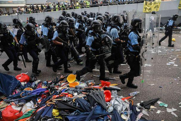 PHOTO: Police advance towards protesters during a rally against a controversial extradition law proposal outside the government headquarters in Hong Kong, June 12, 2019. (Dale De La Rey/AFP/Getty Images)