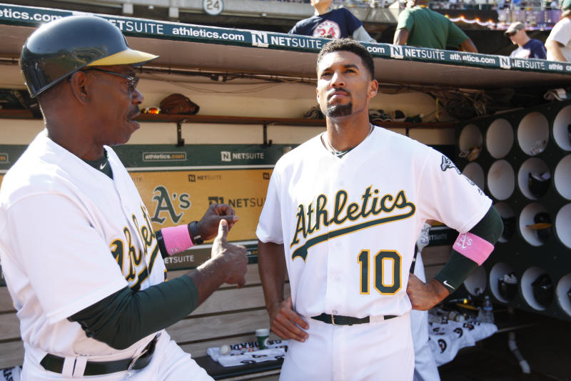 OAKLAND, CA - SEPTEMBER 4: Third Base Coach Ron Washington #38 and Marcus Semien #10 of the Oakland Athletics talk in the dugout during the game against the Boston Red Sox at the Oakland Coliseum on September 4, 2016 in Oakland, California. The Athletics defeated the Red Sox 1-0. (Photo by Michael Zagaris/Oakland Athletics/Getty Images)