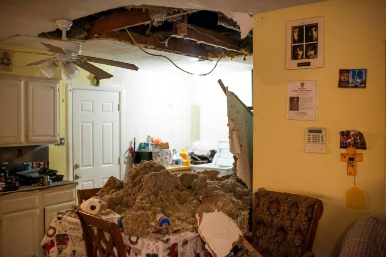 The ceiling of a home collapsed from the force of the deadly explosion at an industrial business (AFP Photo/Mark Felix)