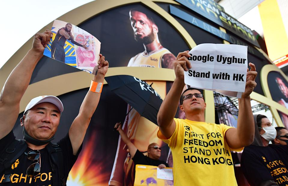 Pro-Hong Kong activists protested LeBron James outside Staples Center ahead of the NBA season opener. (Frederic J. Brown/AFP via Getty Images)