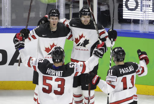 Canada's players celebrate after scoring their side's first goal during the Ice Hockey World Championships bronze medal match between Canada and the United States at the Royal arena in Copenhagen, Denmark, Sunday, May 20, 2018. (AP Photo/Petr David Josek)