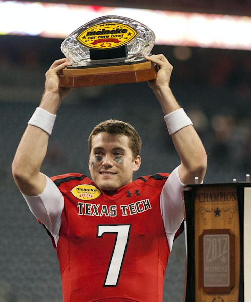 Texas Tech quarterback Seth Doege holds the championship trophy after winning the Meineke Car Care Bowl NCAA college football game against Minnesota, Friday, Dec. 28, 2012, in Houston. Texas Tech defeated Minnesota 34-31. (AP Photo/Dave Einsel)