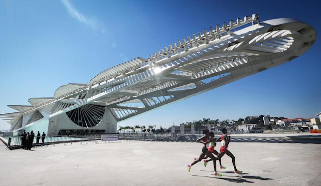 <p>Runners pass the Museum of Tomorrow in the Women's Marathon on Day 9 of the Rio 2016 Olympic Games on August 14, 2016 in Rio de Janeiro, Brazil. (Photo by Mario Tama/Getty Images) </p>