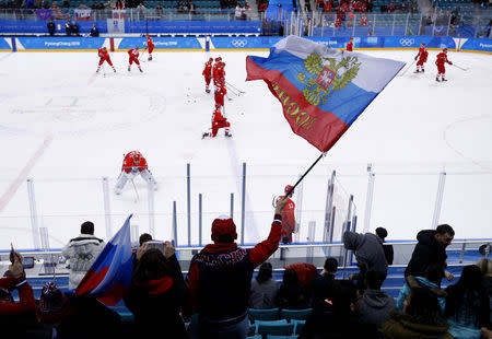 Ice Hockey - Pyeongchang 2018 Winter Olympics - Men's Preliminary Round Match - Olympic Athletes from Russia v U.S. - Gangneung Hockey Centre, Gangneung, South Korea - February 17, 2018 - Russian fan waves a flag before the game. REUTERS/Brian Snyder