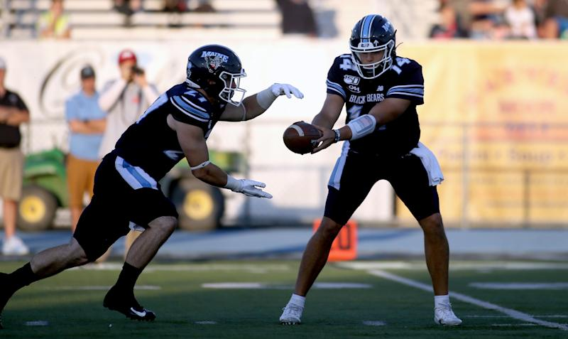 Maine quarterback Chris Ferguson hands the ball off to Joe Fitzpatrick. (Ben McCanna/Getty Images)