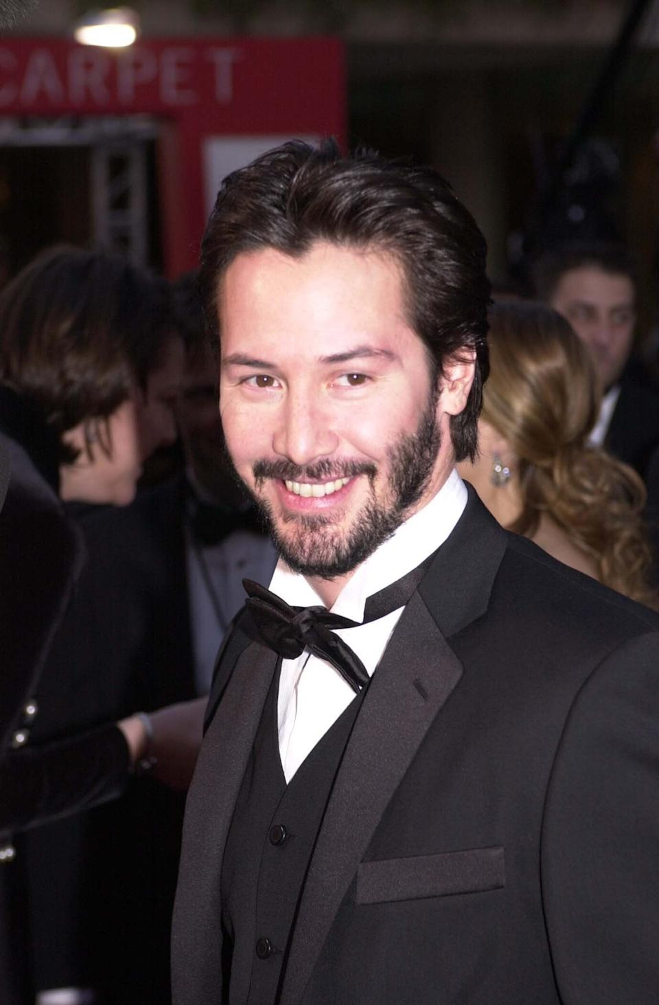 Reeves pose atthe 58th Annual Golden Globe Awards at the Beverly Hilton Hotel.