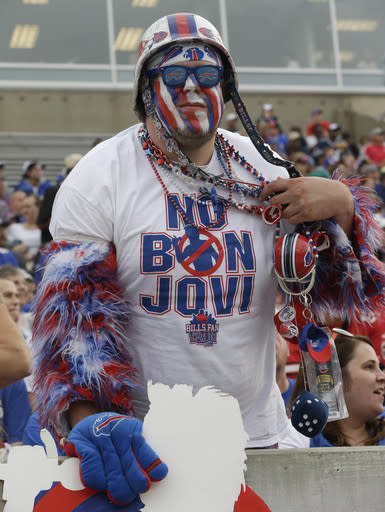 In this Aug. 2, 2014, photo Buffalo Bills fan Jacob Gauda shows off his No Bon Jovi shirt during the 2014 Pro Football Hall of Fame Enshrinement ceremonies at the Pro Football Hall of Fame in Canton, Ohio. Bon Jovi is hoping he's written a hit with Buffalo Bills fans in a bid to stem concerns of whether his prospective ownership group plans to buy and potentially relocate the franchise to Toronto. (AP Photo/Tony Dejak)