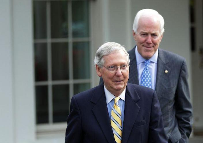Senate Majority Leader Mitch McConnell and Senate Majority Whip John Cornyn come out from the West Wing of the White House to speak to the media Tuesday. (Photo: Alex Wong/Getty Images)