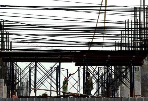 Thai labourers work at a construction site in Bangkok  in March 2012
