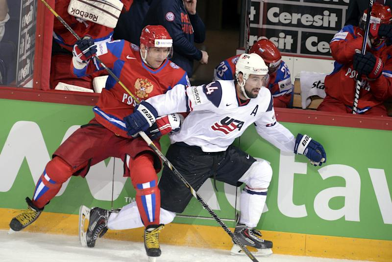 Russia's Alexander Ovechkin, left, checks Nate Thompson of team USA during the 2013 Ice Hockey IIHF World Championships Group B Quarterfinal match Russia vs USA in Helsinki, Finland on Thursday  May 16, 2013. (AP Photo/LEHTIKUVA / Martti Kainulainen) FINLAND OUT