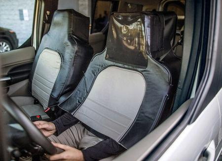 "The Ford and Virginia Tech research simulated a self-driving vehicle using a ""seat suit"" to conceal the human driver in Arlington"