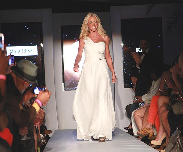 Kate Gosselin can add runway model to her resumé. The former reality TV star made her New York Fashion Week debut on Sept. 12 at the 'Real Fashion, Real Women' runway show benefitting the Bottomless Closet, which provides women in need with clothes to help them enter and succeed in the workforce. The mom of eight looked healty, toned and tanned in a one-shoulder white gown. (Photo by Taylor Hill/Getty Images)