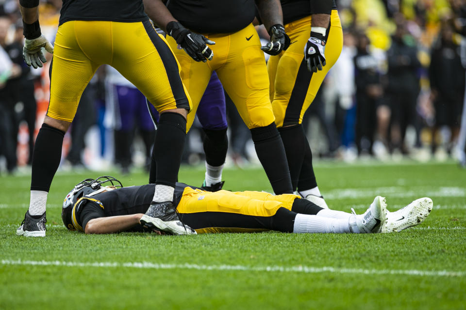 Pittsburgh Steelers quarterback Mason Rudolph (2) lays flat on the turf after a hit by Baltimore Ravens free safety Earl Thomas. (Getty Images)