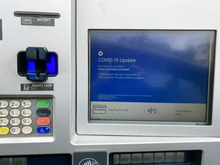 FILE PHOTO: A Chase bank drive-through ATM screen is seen with a COVID-19 message in Los Angeles