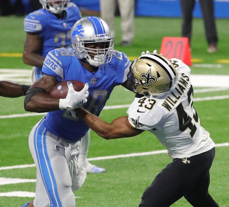 Detroit Lions running back Adrian Peterson runs through New Orleans Saints safety Marcus Williams for a touchdown during the fourth quarter Sunday, October 4, 2020 at Ford Field.