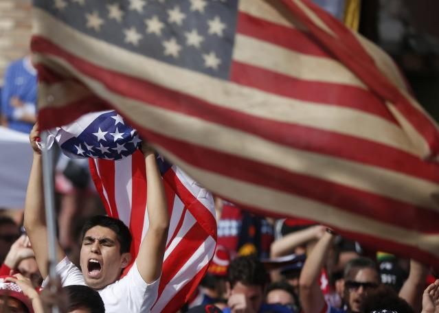 Fans cheer after the U.S. scored a second goal during the 2014 Brazil World Cup Group G soccer match between Ghana and the U.S. at a viewing party in Hermosa Beach, California June 16, 2014. REUTERS/Lucy Nicholson (UNITED STATES - Tags: SOCCER SPORT WORLD CUP)