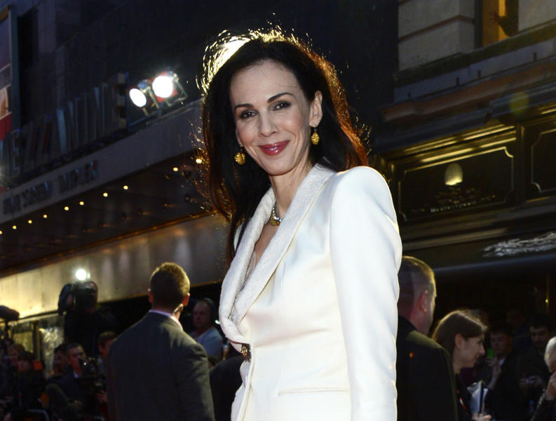 """FILE - This Oct. 18, 2012 file photo shows fashion designer L'Wren Scott at the London Film Festival American Express Gala for """"The Rolling Stones - Crossfire Hurricane"""", in London. Scott is to be remembered on Friday, May 2, 2014, at a Manhattan memorial service, expected to be attended by her longtime companion, Mick Jagger, and others close to her. The service for Scott, a noted fashion designer and stylist who committed suicide March 17, will be held at St. Bartholomew's Church. (Photo by Jon Furniss/Invision, File)"""